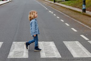 Child crossing the road