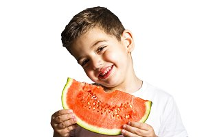 Funny kid eating watermelon