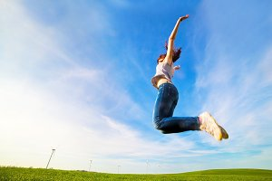 Woman jumping for joy on the field
