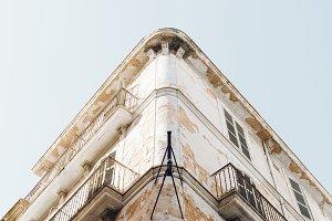Grunge house facade blue sky