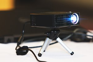 Black projector with tripod
