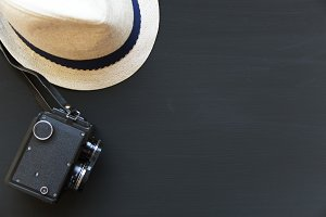 Vintage camera, hat on dark
