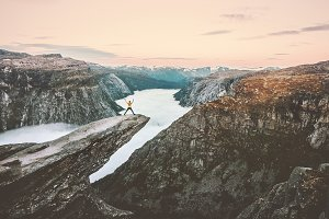 Man jumping on the edge Trolltunga