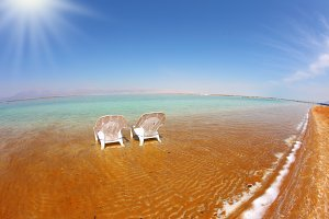 Two white beach chairs
