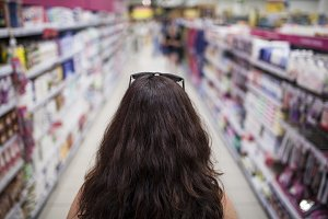 woman from behind in market aisle