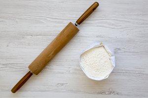 Flour on white wooden background