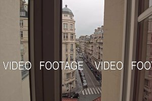 Timelapse of traffic in Parisian street, view through window