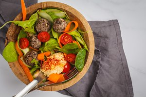 Vegan bowl with hummus, meatballs