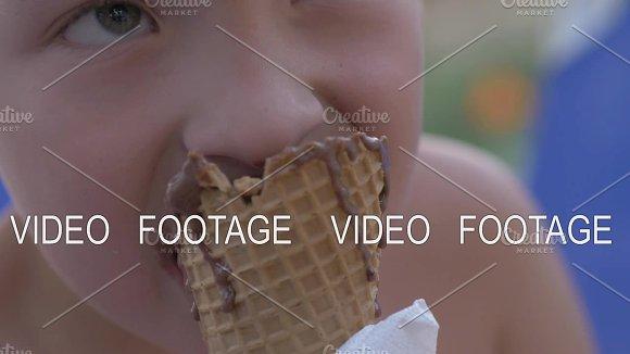 Boy Eating Chocolate Ice Cream Cone