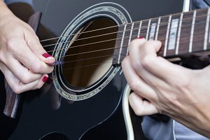 female hand and guitar