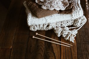 Knitwear Stack with Knitting Needles