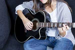 woman playing an acoustic guitar