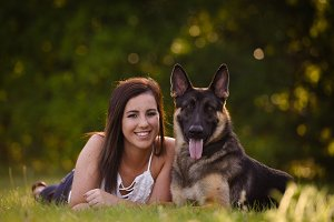 Young woman with German Shepherd dog