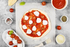 Pizza with cheese, tomatoes, basil