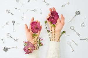 Conceptual photo. Hands with flowers
