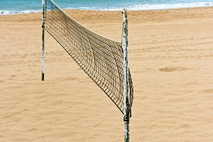 Volleyball net on a sand beach by