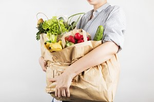 Woman holding papers shopping bag