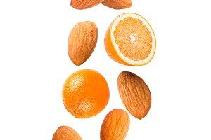 Falling orange fruit and almonds