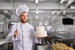 Confectioner with a cake in the bakery.