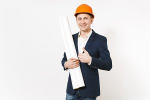Smiling businessman in dark suit, protective construction helmet holding blueprints plans and showing thumb up isolated on white background. Male worker for advertisement. Business, working concept.