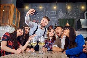 Friends do selfie on the phone at  bar restaurant
