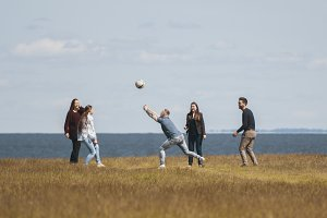 Group of young friends playing outdoor games on the hill