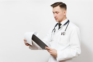 Serious experienced handsome young doctor man isolated on white background. Male doctor in medical uniform, stethoscope health card on notepad folder. Healthcare personnel, health, medicine concept.