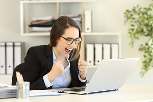 Excited office worker reading online