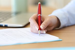 businesswoman hand signing a contrac
