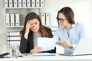 Boss scolding an intern