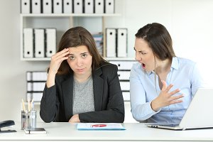 Boss scolding an emlployee