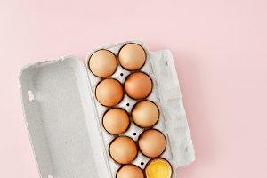 Chicken egg is half broken flat lay