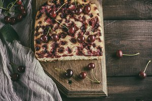 baked cake with cherries