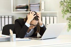 Sad office worker complaining