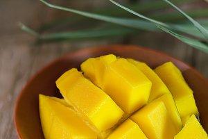 Fresh mango on wooden background.