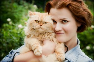 Woman with Persian cat