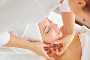 Beautiful woman at a facial massage.