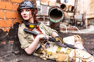 Powerful Woman Holding Gun. War Action Movie Style