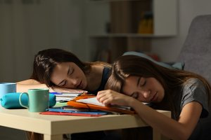 Two tired students sleeping