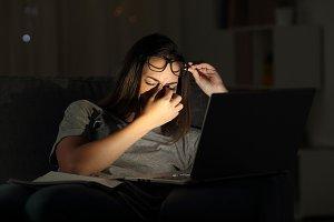 Tired woman suffering eyestrain