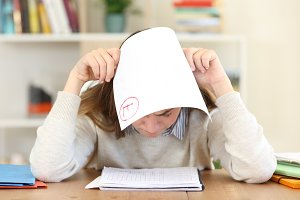 sad student covering head