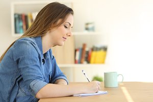 relaxed woman writing a note