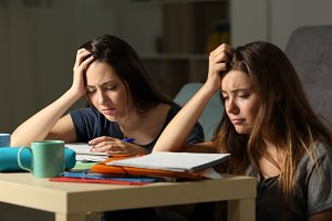 Frustrated students studying hard