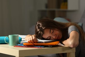 Exhausted student sleeping