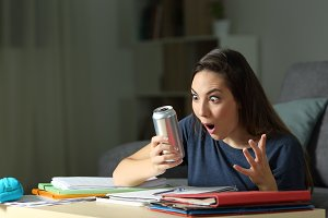 Student looking at energy drink