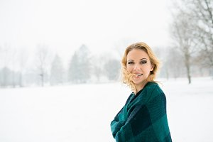 Blond woman throwing her hair outside in winter nature