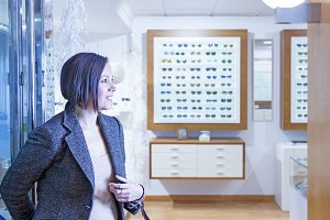 woman entering into optician store
