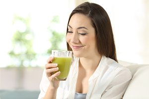 woman tasting a good vegetable juice