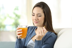 Woman holding an orange juice