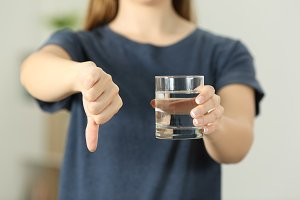 woman hands holding a water glass
